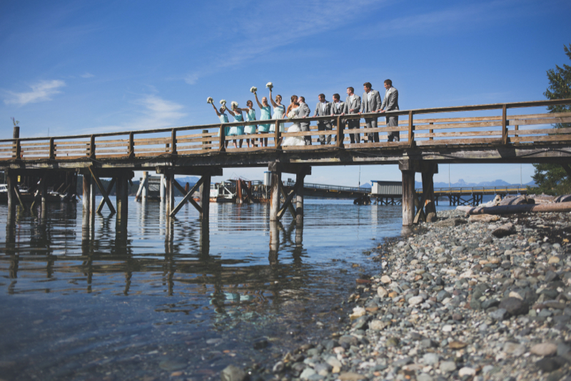 bridal party on the dock at heriot bay inn