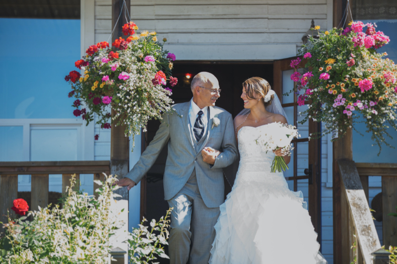 ashley and father at wedding smiling