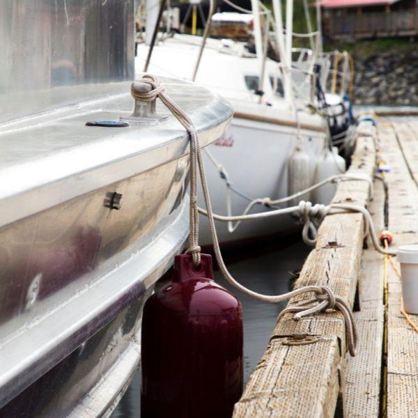 Boat tied to dock at Heriot Bay Marina